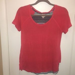 Coral tee shirt with patterned back